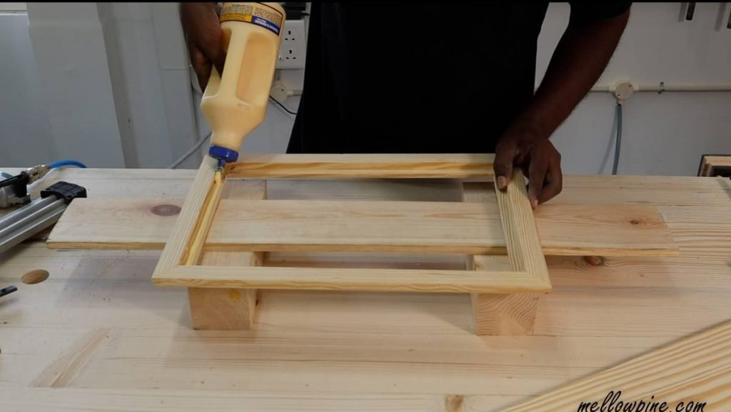 gluing the board onto the frame