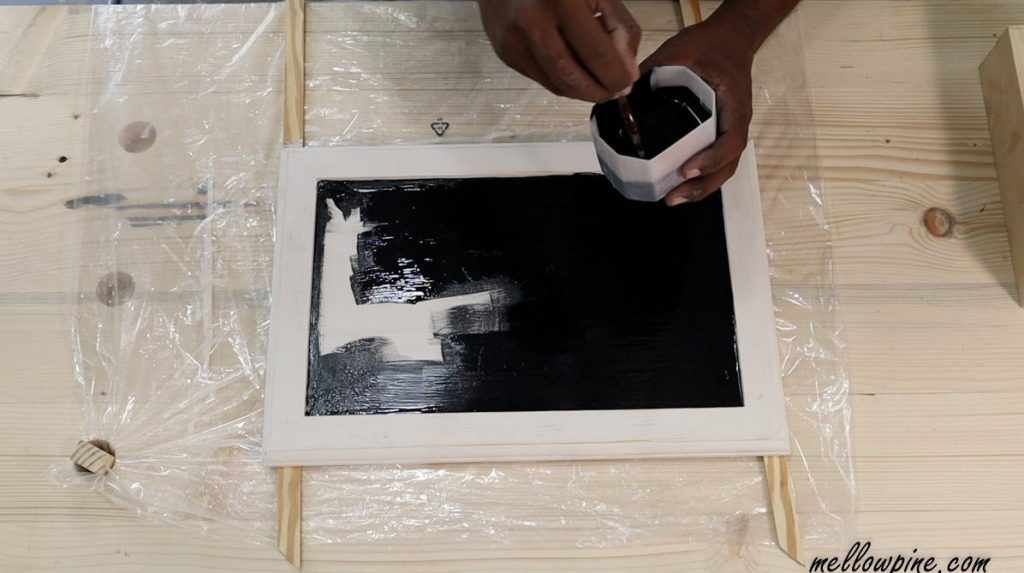 applying chalkboard paint on the tray