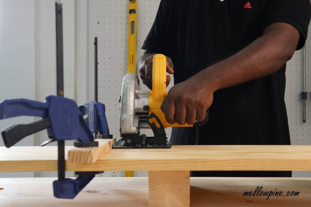 cutting the board using circular saw