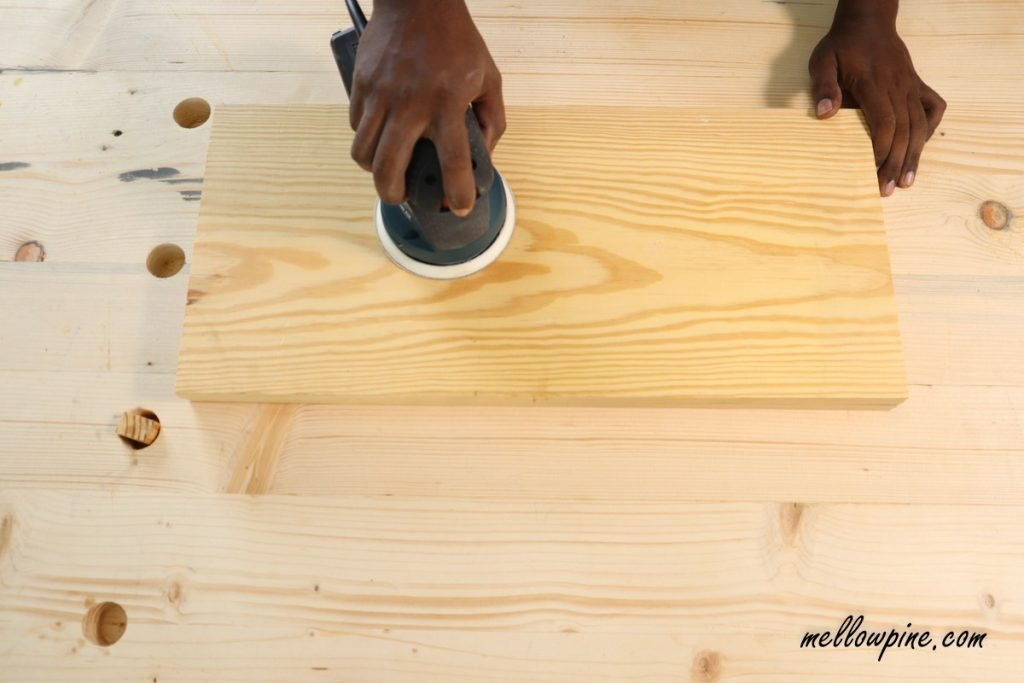 sanding boards using sander