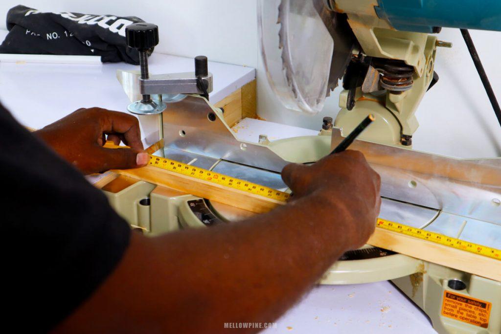 cutting the lumber using miter saw