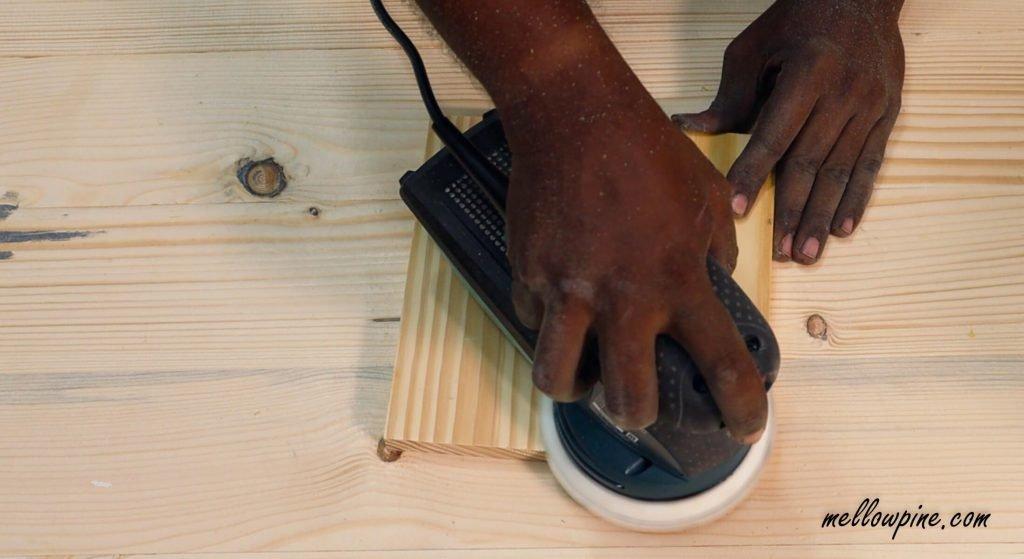 sanding the base piece