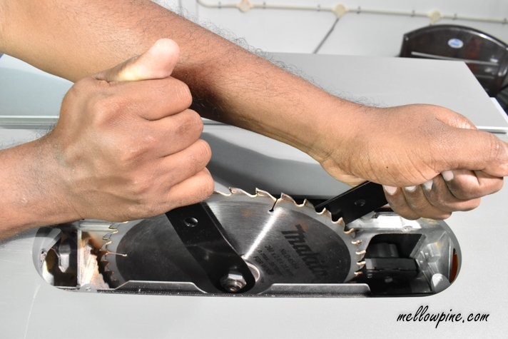 tightening the nut table saw blade
