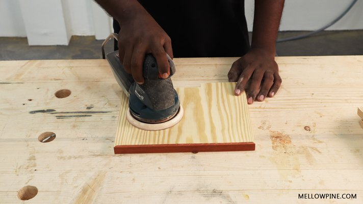 sanding the wood pieces