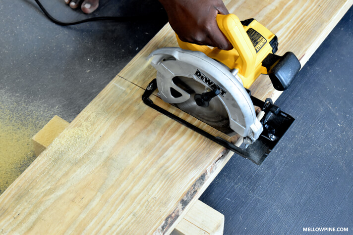 Cutting the boards for the leg pieces of the bench
