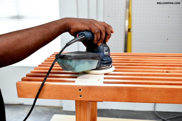 Sanding the edge grain of the legs using double grit sandpaper