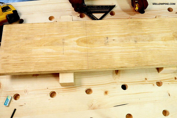 Marking the size for cutting the board for the leg piece