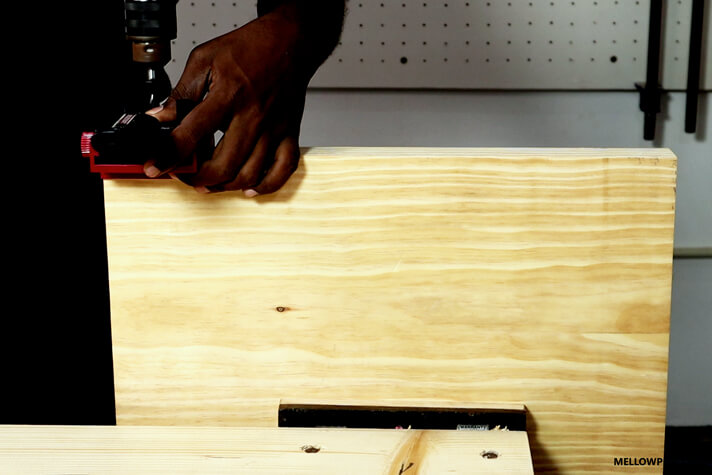 Making the dowel hole on the board for the leg