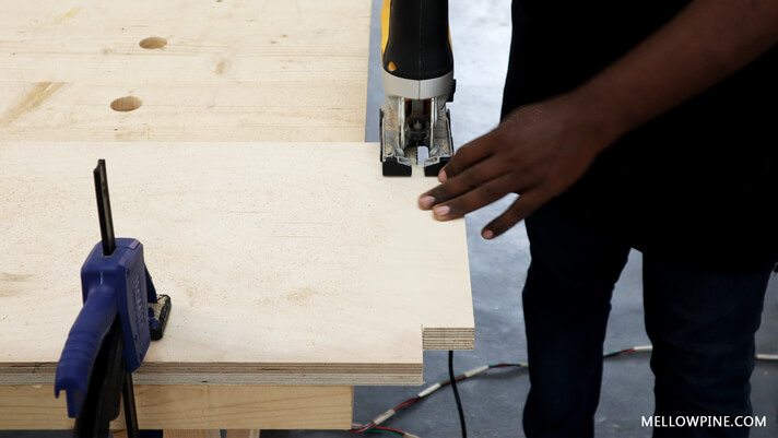 Cutting the slots for the legs in the shelf plywood