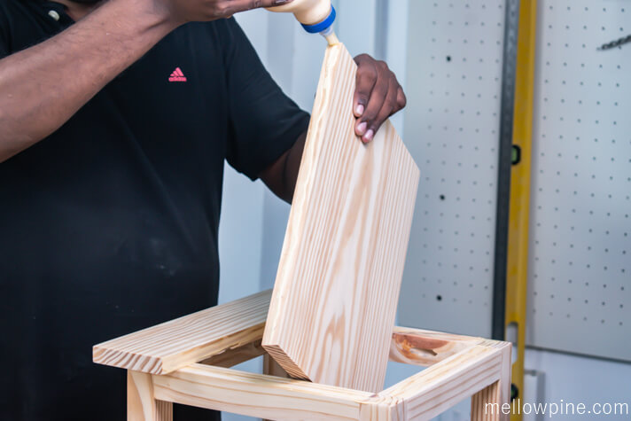 Applying wood glue on the larger top piece