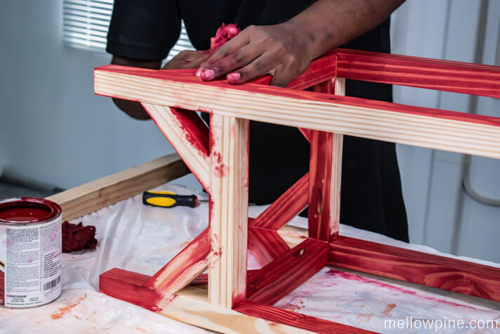 Staining the bar stool with barn red finish