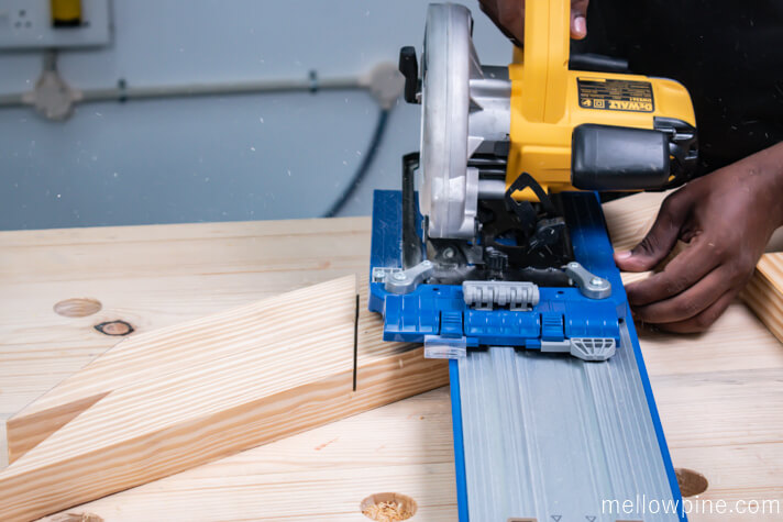 Making cuts in the X brace before chiseling using circular saw