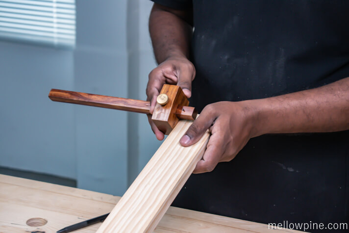 Marking the shape of the dovetail on the bottom bracing piece
