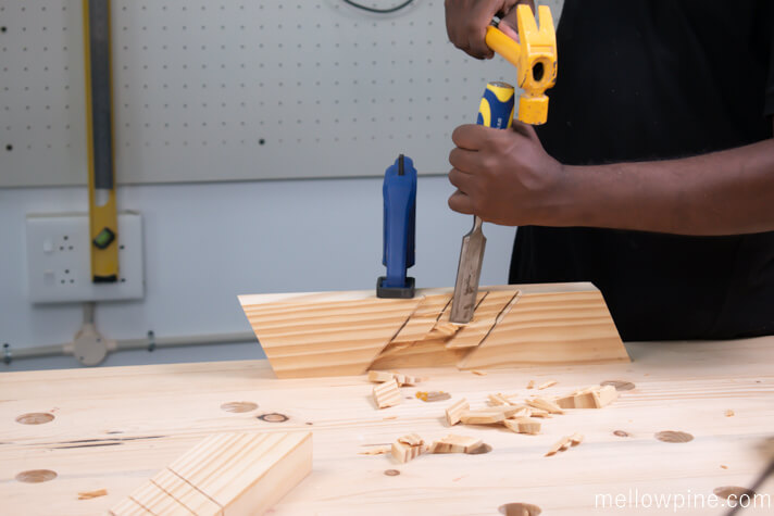 Chiseling the wood for half lap slots