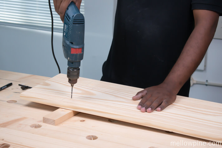 Drilling the pilot hole for joining the top piece to the leg piece