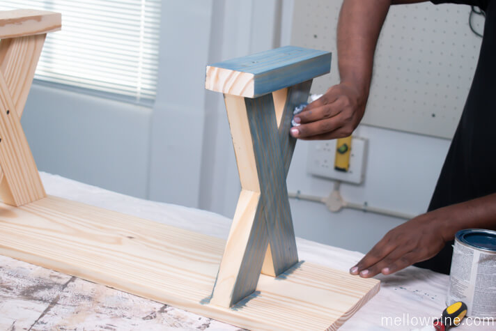 Applying stain to the X Bench