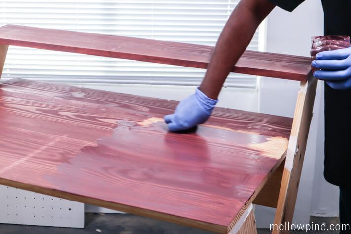 Applying barn red stain