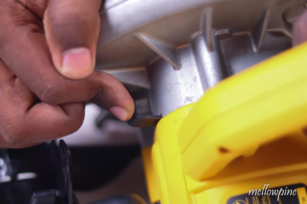 Pressing arbor lock button