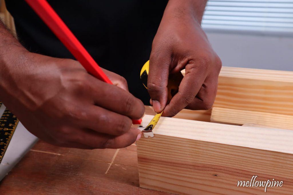 Marking the rabbet cut dimensions on the wood at both ends
