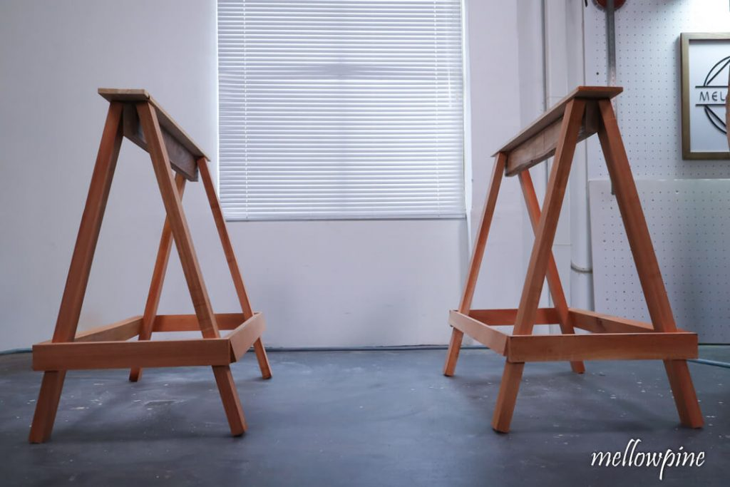 Sawhorse sitting parallel to each other